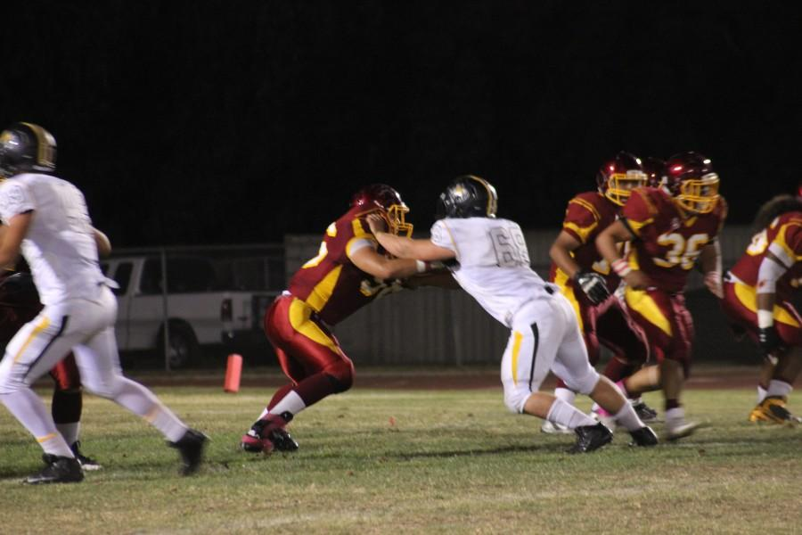 Oxnard's defensive line protecting their quarterback.