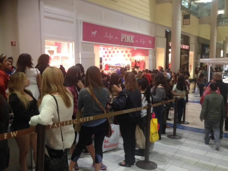 Shoppers waiting in a line to enter Victoria's Secret at the Pacific View Mall