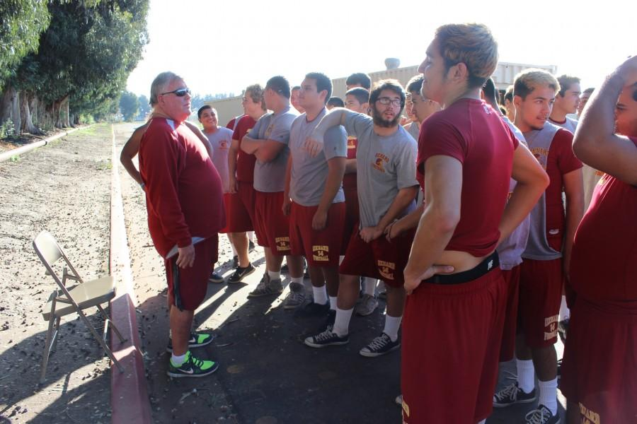 Recently retired coach Mark Beckham speaking to next years' varsity football players.