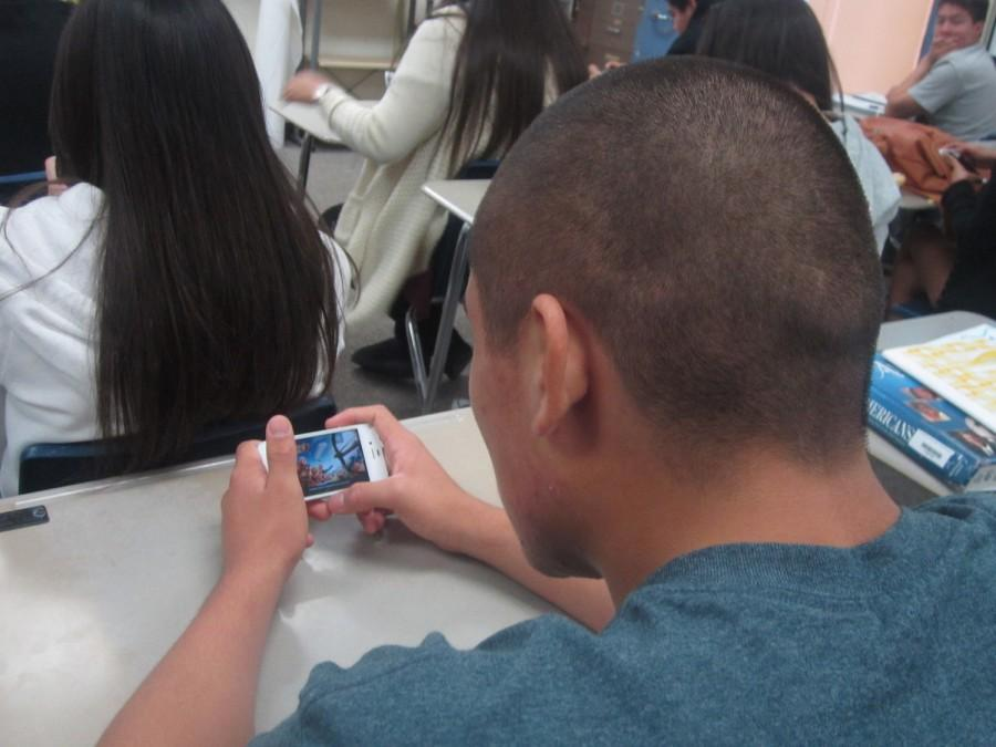 People playing Clash Of Clan in class.