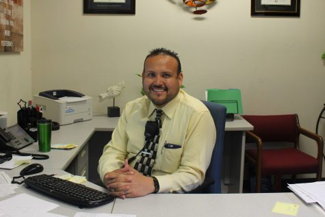 Mr.Verdin in his office, posing for a photo.